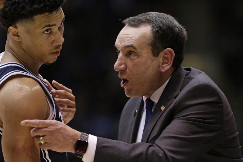 Duke head coach Mike Krzyzewski, right, speaks with guard Jordan Goldwire, left, during the second half of an NCAA college basketball game against Wake Forest in Durham, N.C., Saturday, Jan. 11, 2020. (AP Photo/Gerry Broome)