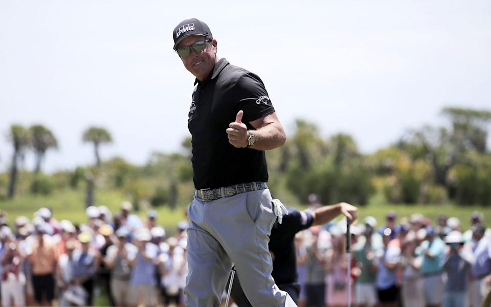 Phil Mickelson salutes the fans - SHUTTERSTOCK