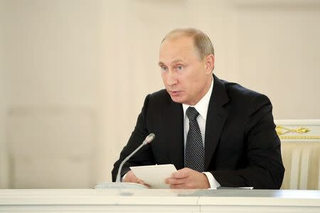 Russian President Vladimir Putin chairs a meeting of the presidential council at the Kremlin in Moscow