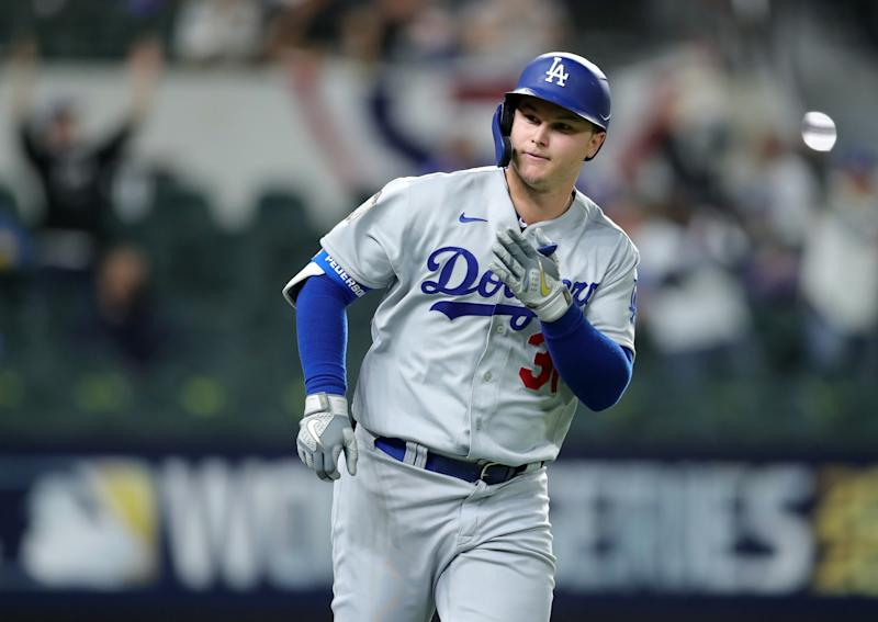 Joc Pederson of the Los Angeles Dodgers reacts after hitting a home run in Game 5 of the 2020 World Series. (Photo by Kelly Gavin/MLB Photos via Getty Images)