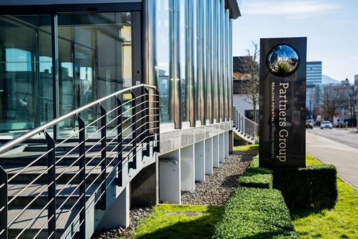 A view of the exterior and entrance of Partners Group's global headquarters in Zug