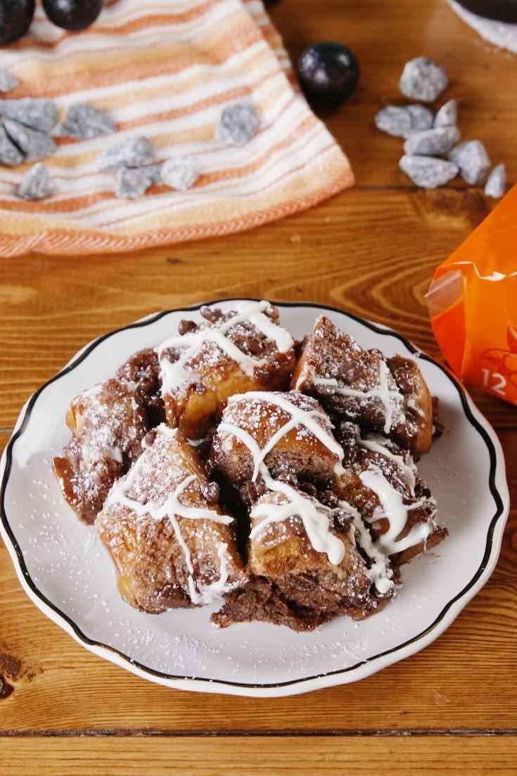 """<p>This chocolatey bread pudding is perfect for your spooky party.</p><p>Get the recipe from <a href=""""https://www.delish.com/cooking/recipe-ideas/a22827388/moon-rock-bread-pudding-recipe/"""" rel=""""nofollow noopener"""" target=""""_blank"""" data-ylk=""""slk:Delish"""" class=""""link rapid-noclick-resp"""">Delish</a>.</p>"""