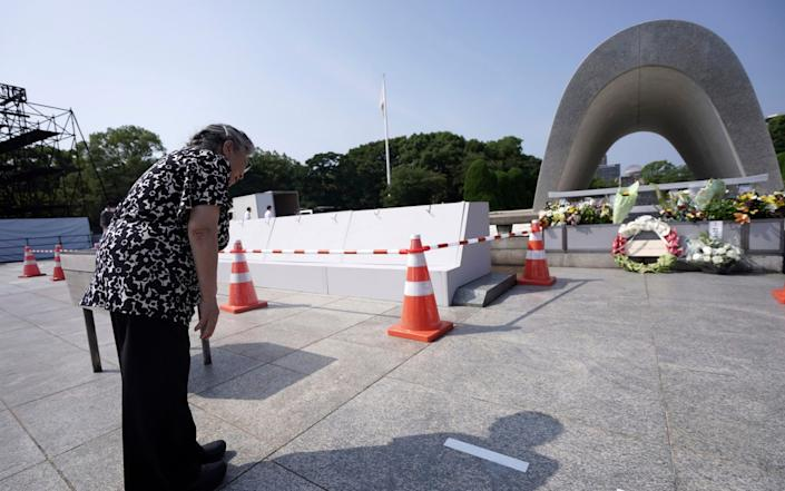Koko Kondo prays at the cenotaph for the atomic bombing victims - Eugene Hoshiko /AP
