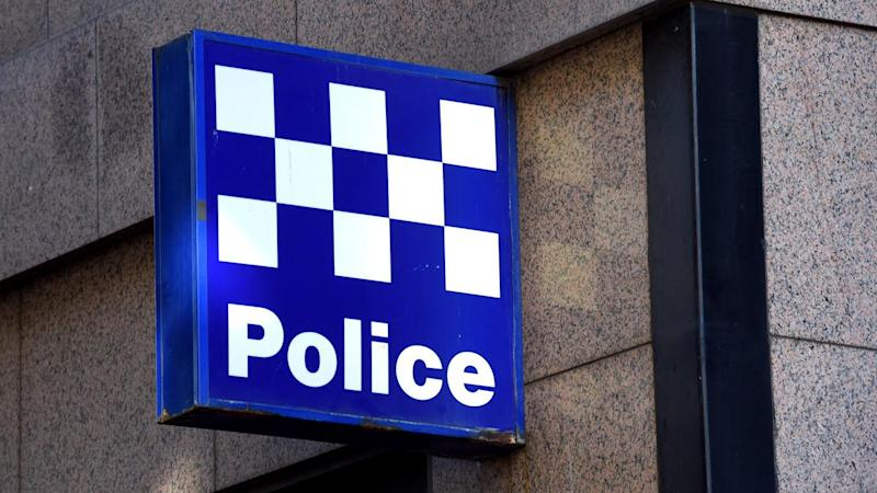 A woman has been arrested after a man was killed by a car in a Melbourne carpark.