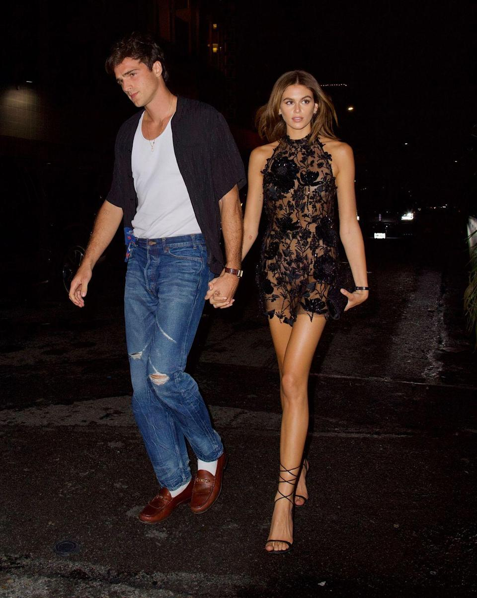 """<p>The model changed out of her vintage gown and into a sheer floral appliqué mini dress to head to a party <a href=""""https://www.elle.com/uk/life-and-culture/a36473646/kaia-gerber-jacob-elordi-relationship/"""" rel=""""nofollow noopener"""" target=""""_blank"""" data-ylk=""""slk:with boyfriend Elordi."""" class=""""link rapid-noclick-resp"""">with boyfriend Elordi.</a></p>"""