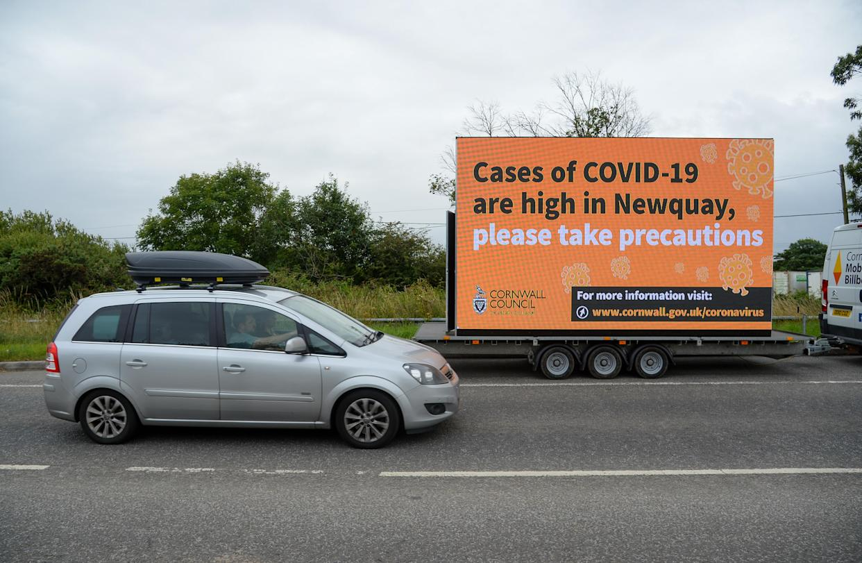 NEWQUAY, ENGLAND - JULY 29: A mobile Cornwall council billboard stating that cases of COVID-19 are high in Newquay is seen on July 29, 2021 in Newquay, United Kingdom. (Photo by Finnbarr Webster/Getty Images)