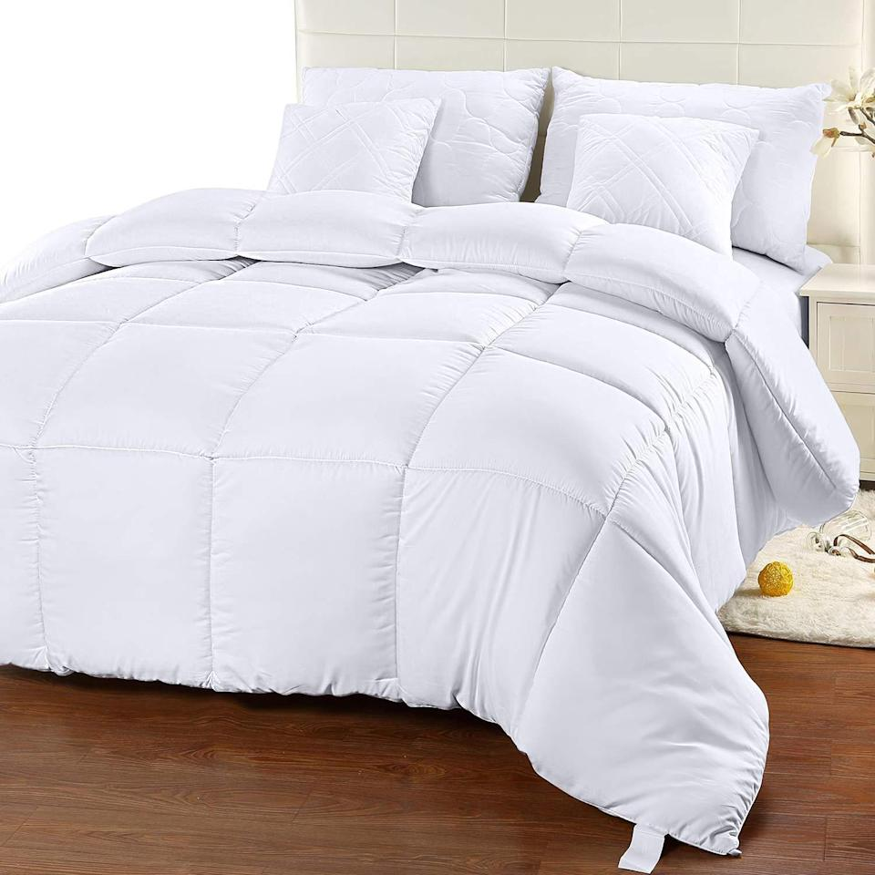 "<h2>Utopia Quilted Comforter Insert</h2><br>This quilted down comforter is both luxe-feeling and affordable, so it's a total win-win. Cuddle with this fluffy fiber-filled cloud shaped comforter to revel in a delightful sleep. <br><br><strong>The Hype:</strong> 4.7 out of 5 stars and 49,561 reviews on <a href=""https://amzn.to/32hKHda"" rel=""nofollow noopener"" target=""_blank"" data-ylk=""slk:Amazon"" class=""link rapid-noclick-resp"">Amazon</a> <br><br><strong>Comfort Seekers Say:</strong> ""I didn't want to break the bank when I got a new bed set, but I was worried that buying the cheaper product would result in less comfort. I was wrong! This cloud-like duvet is SO comfortable and soft. It is light and heavy at the same time, and you feel that sense of security that a blanket gives you, but it doesn't make you wish you were dead in the summertime."" –– <em>Kylie, Amazon Reviewer </em><br><br><strong>Utopia Bedding</strong> Utopia Quilted Comforter Insert, $, available at <a href=""https://amzn.to/3p5Ib3q"" rel=""nofollow noopener"" target=""_blank"" data-ylk=""slk:Amazon"" class=""link rapid-noclick-resp"">Amazon</a>"