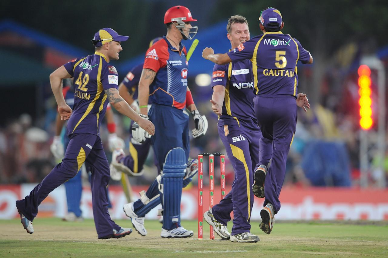 PRETORIA, SOUTH AFRCA - OCTOBER 13:  Brett Lee (2nd R) of the Knight Riders celebrates capturing the wicket of Kevin Pietersen (2nd L) of the Daredevils with Brendon McCullum (L) and Gautam Gambhir (R) during the Karbonn Smart CLT20 Group A match between Kolkata Knight Riders (IPL) and Delhi Daredevils (IPL) at SuperSport Park on October 13, 2012 in Pretoria, South Africa.  (Photo by Lee Warren/Gallo Images/Getty Images)