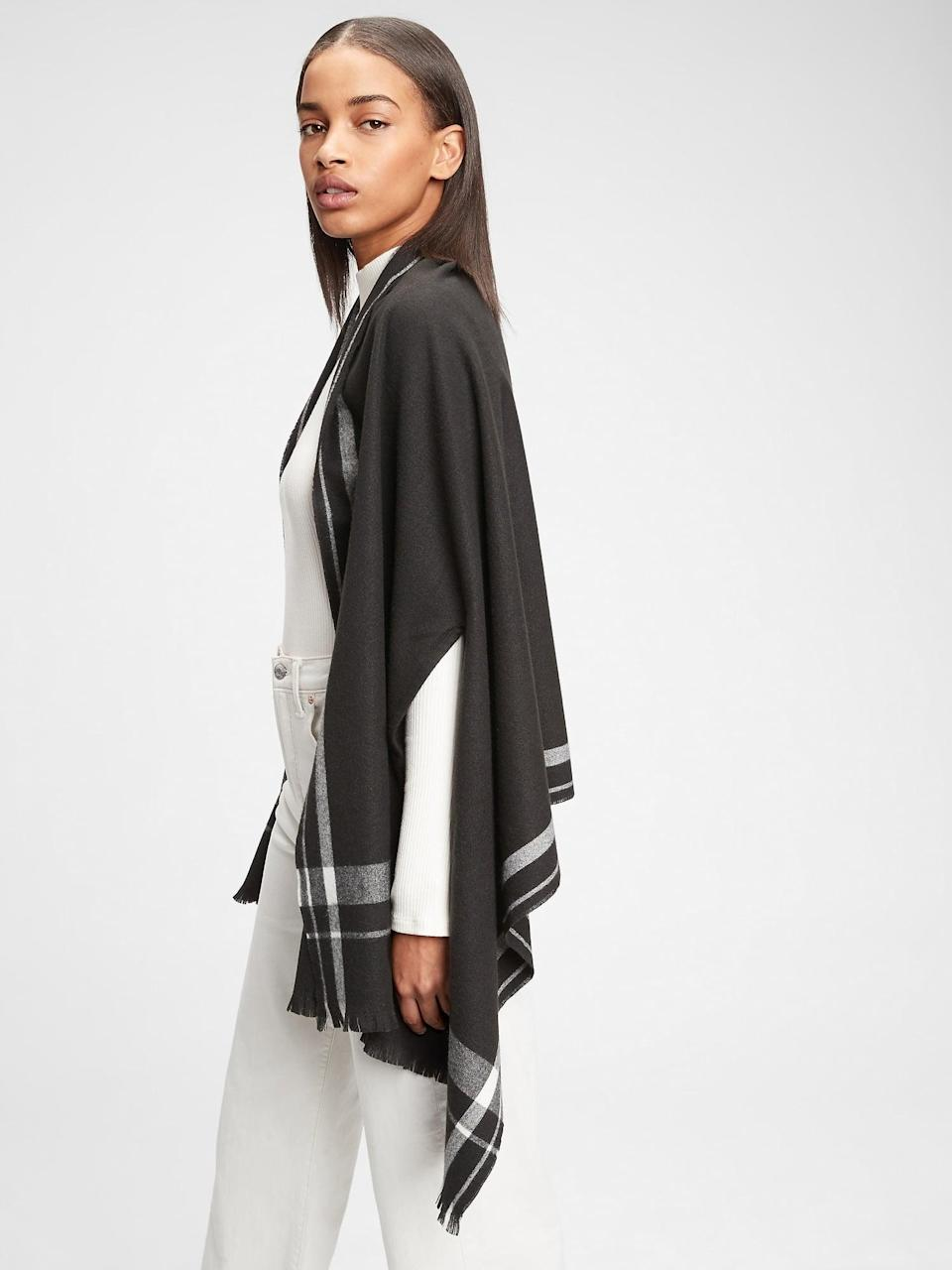 "<p>This <span>Gap Cape Scarf</span> ($24, originally $50) is the most elegant ""little thing to throw on""!</p>"