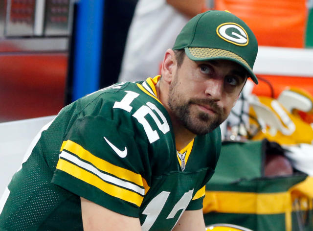 FILE - In this Oct. 8, 2017, file photo, Green Bay Packers quarterback Aaron Rodgers sits on the sideline during an NFL football game against the Dallas Cowboys in Arlington, Texas. An offseason of change for the Packers has been met with occasional displeasure by Rodgers. (AP Photo/Michael Ainsworth, File)