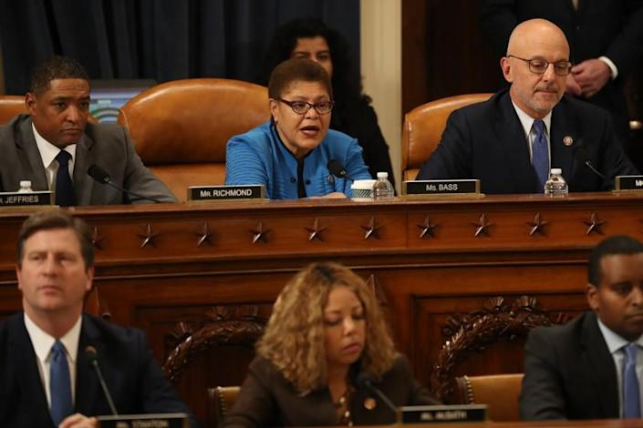 """Rep. Karen Bass (D-Los Angeles), center, a member of the House Judiciary Committee, announces her vote in favor of the first of two articles of impeachment on Dec. 13, 2019. <span class=""""copyright"""">(Chip Somodevilla / Getty Images)</span>"""