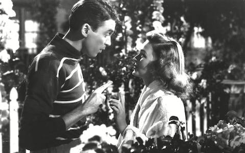James Stewart and Donna Reed in It's a Wonderful Life - Credit: Rex Features