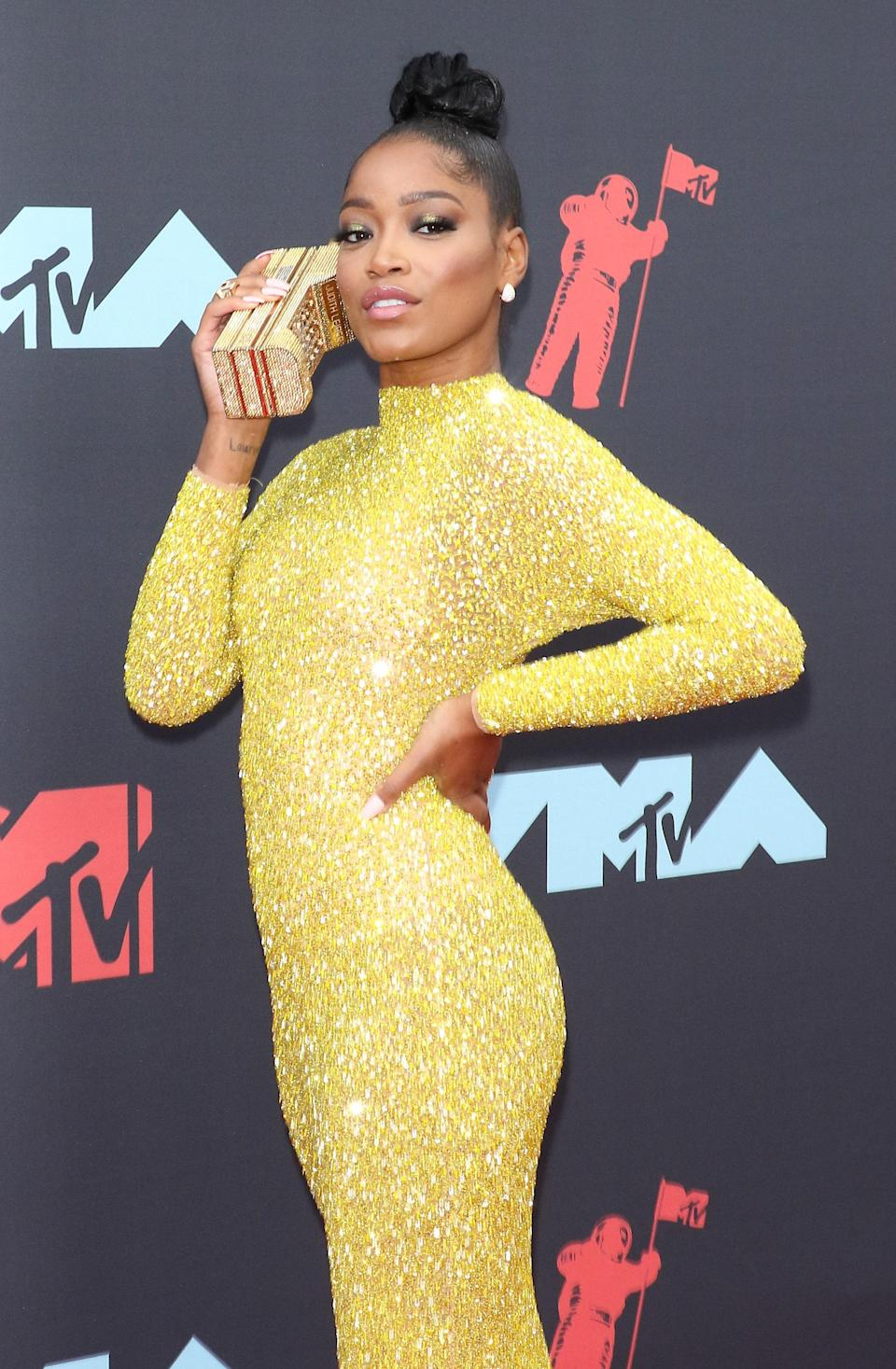 You can never go wrong with gold eye makeup, contoured cheeks, and a sleek bun and 2020 host Keke Palmer knows this well.