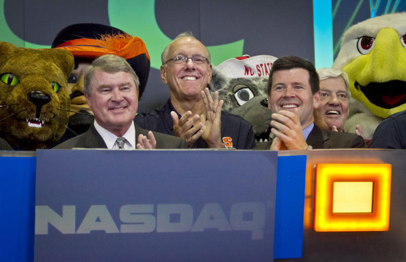 Atlantic Coast Conference commissioner John Swofford, far left, Syracuse basketball coach Jim Boeheim, second from left, NASDAQ head of listings Bob McCooey, second from right, and Virginia Tech football coach Frank Beamer, far right, reacts during the ringing of the closing bell on Monday, July 1, 2013 in New York. The ACC visited the NASDAQ Market Site in Times Square to officially announce the addition of its three new members in Notre Dame, Pitt and Syracuse. (AP Photo/Bebeto Matthews)