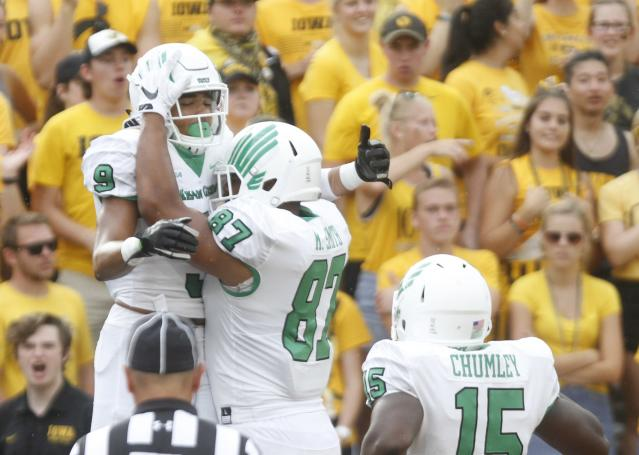 "IOWA CITY, IOWA- SEPTEMBER 16: Wide receiver Jalen Guyton #9 of the <a class=""link rapid-noclick-resp"" href=""/ncaab/teams/nax/"" data-ylk=""slk:North Texas Mean Green"">North Texas Mean Green</a> celebrates with tight end <a class=""link rapid-noclick-resp"" href=""/ncaaf/players/254742/"" data-ylk=""slk:Kelvin Smith"">Kelvin Smith</a> #87 after scoring a touchdown in the second quarter against the <a class=""link rapid-noclick-resp"" href=""/ncaab/teams/ian/"" data-ylk=""slk:Iowa Hawkeyes"">Iowa Hawkeyes</a>, on September 16, 2017 at Kinnick Stadium in Iowa City, Iowa. (Photo by Matthew Holst/Getty Images)"