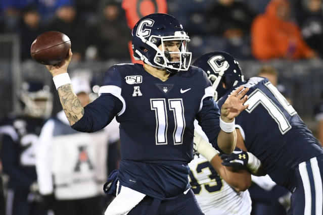 Connecticut quarterback Jack Zergiotis (11) looks for a receiver during the first half of the team's NCAA college football game against Navy on Friday, Nov. 1, 2019, in East Hartford, Conn. (AP Photo/Stephen Dunn)