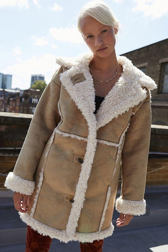 """<br><br><strong>BDG Urban Outfitters</strong> Faux Shearling Coat, $, available at <a href=""""https://www.urbanoutfitters.com/en-gb/shop/uo-faux-shearling-beige-longline-coat?inventoryCountry=GB&currency=GBP&currency=GBP&color=024&size=M&cm_mmc=rakuten-_-affiliates-_-ShopStyle%20UK-_-1&utm_medium=affiliates&utm_source=LS&utm_campaign=ShopStyle%20UK&utm_term=693672&utm_content=1&ranMID=43613&ranEAID=0RpXOIXA500&ranSiteID=0RpXOIXA500-4eGANetiRigviN9WGO5X7g&type=REGULAR&quantity=1"""" rel=""""nofollow noopener"""" target=""""_blank"""" data-ylk=""""slk:Urban Outfitters"""" class=""""link rapid-noclick-resp"""">Urban Outfitters</a>"""