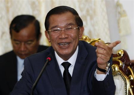 Hun Sen smiles during a meeting with Sam Rainsy at Cambodia's National assembly in central Phnom Penh