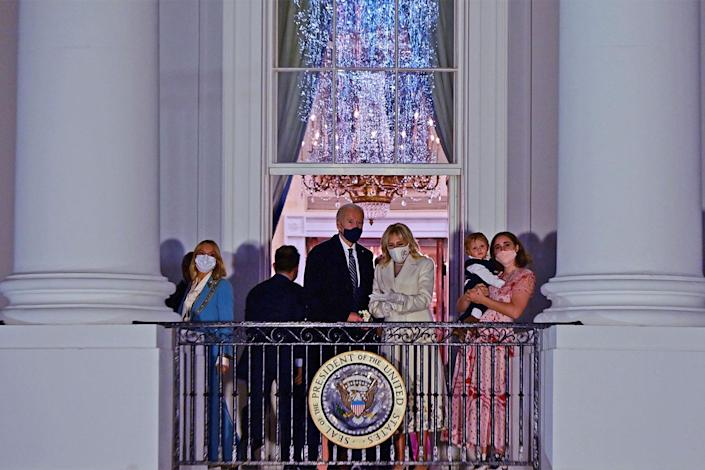 <p>The Biden family gathered on the White House's Blue Room balcony to take in the inauguration entertainment.</p>