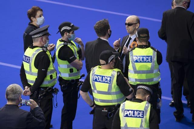 Liberal Party members and police