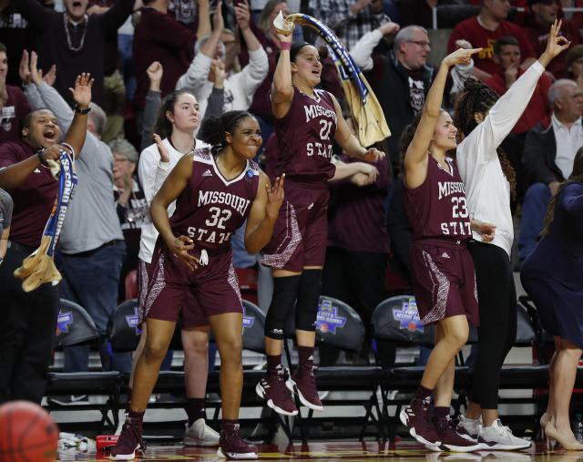 FILE - In this Monday, March 25, 2019, file photo, Missouri State forward Jasmine Franklin, left, guard Sydney Wilson, center, and guard Mya Bhinhar, right, celebrate a 3-point basket by guard Sydney Manning during the second half against Iowa State in the second round of the NCAA women's college basketball tournament, in Ames, Iowa. In the first week of December 2019, Missouri State is ranked for the first time in 15 years. Franklin, Wilson and Bhinhar are returning players from a squad that reached last season's Sweet 16. (AP Photo/Matthew Putney, File)