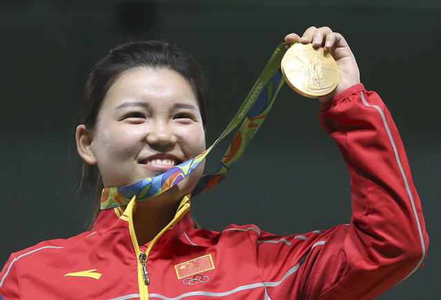 <p>Zhang Mengxue of China holds her gold medal during the award ceremony for the women's 10-meter air pistol event at Olympic Shooting Center at the 2016 Summer Olympics in Rio de Janeiro, Brazil, Sunday, Aug. 7, 2016. Zhang won the gold medal. Batsarashkina won the silver medal and Korakaki finished with the bronze. (AP Photo/Eugene Hoshiko) </p>