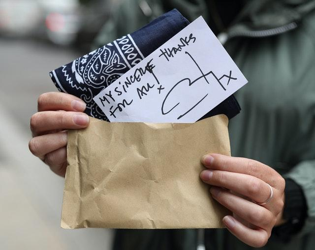 A brown envelope containing a bandana and a handwritten note from actor Johnny Depp was given to supporters at the High Court in London