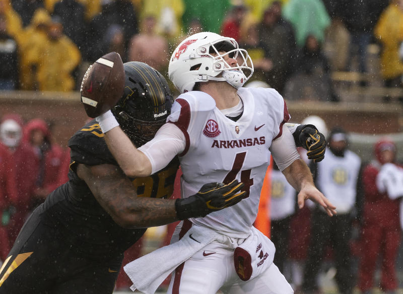 FILE - In this Nov. 23, 2018, file photo, Missouri defensive lineman Jordan Elliott, left, hits Arkansas quarterback Ty Storey, right, causing him to fumble the ball, during the first half of an NCAA college football game in Columbia, Mo. Elliott is expected to emerge as one of Missouri's top defensive players in 2019. (AP Photo/L.G. Patterson, File)