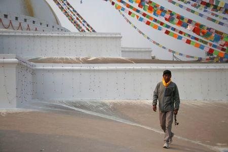 Kami Rita Sherpa, 48, who is attempting a world record by climbing Mount Everest for the 22nd time this season walks along the premises of Boudhanath Stupa in Kathmandu, Nepal March 26, 2018. REUTERS/Navesh Chitrakar