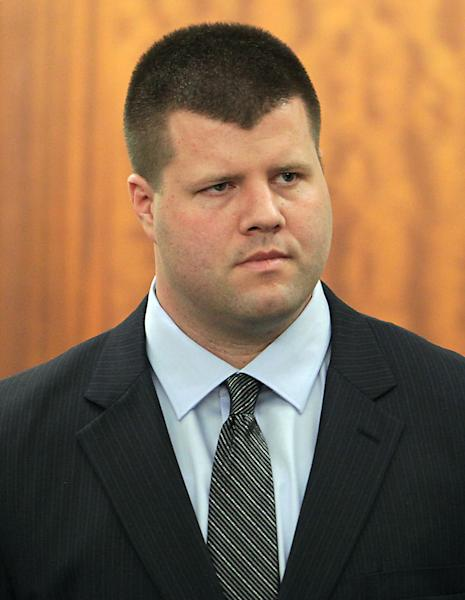 In this Monday, June 3, 2013 photo, former Houston police officer Drew Ryser, the fourth and final Houston police officer accused of wrongdoing in the 2010 videotaped beating of teenage burglar Chad Holley, stands in State District Judge Ruben Guerrero's 174th State District Court during his trial, in Houston. (AP Photo/Houston Chronicle, James Nielsen) MANDATORY CREDIT