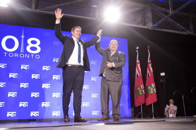 Federal Conservative Leader Andrew Scheer, left, is joined on stage by Ontario Premier Doug Ford after addressing the Ontario PC Convention in Toronto on Nov. 17, 2018.