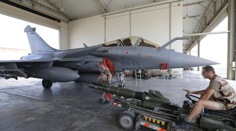French fighter jets targeted weapon caches and a training camp on the southern and western outskirts of the city (AFP Photo/Karim Sahib)