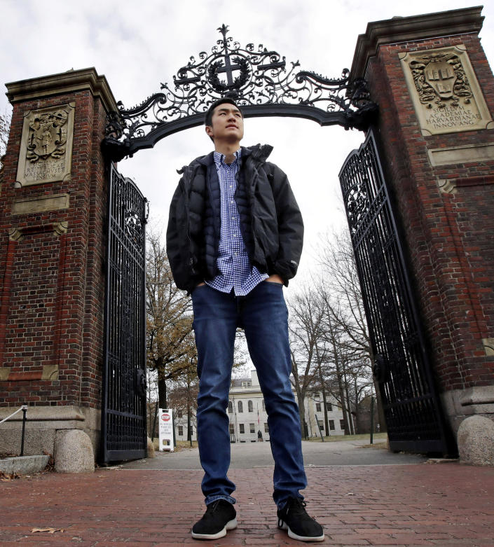 """FILE— In this Dec. 13, 2018 file photograph, Harvard University graduate and Rhodes Scholar Jin K. Park, who holds a degree in molecular and cellular biology, poses outside a gate at Harvard Yard in Cambridge, Mass. Park, the first """"Dreamer"""" to be awarded a prestigious Rhodes Scholarship, finally is heading to England's University of Oxford this fall after 2 1/2 years of limbo brought on by the Trump administration's refusal to let DACA recipients travel abroad. (AP Photo/Charles Krupa, File)"""