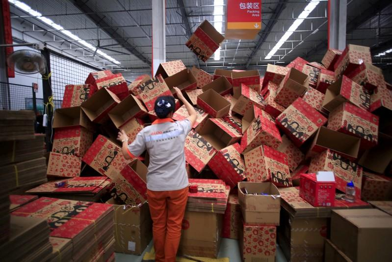 FILE PHOTO: An employee works at a Tmall logistics centre in Suzhou