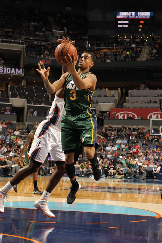 CHARLOTTE, NC - DECEMBER 21: Trey Burke #3 of the Utah Jazz shoots against the Charlotte Bobcats during the game at the Time Warner Cable Arena on December 21, 2013 in Charlotte, North Carolina. (Photo by Kent Smith/NBAE via Getty Images)