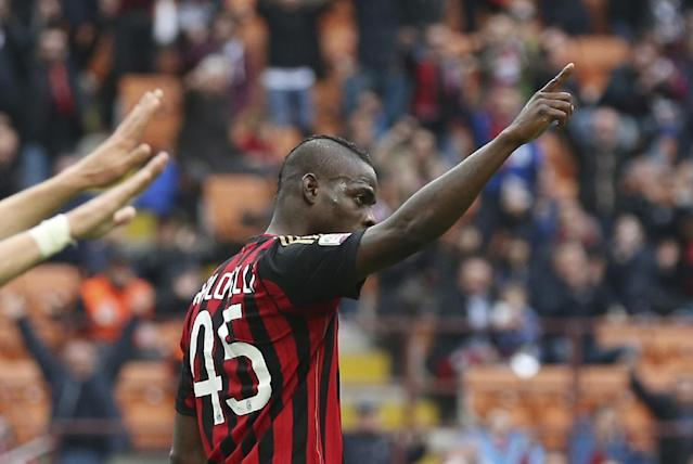 AC Milan forward Mario Balotelli celebrates after scoring during the Serie A soccer match between AC Milan and Livorno at the San Siro stadium in Milan, Italy, Saturday, April 19, 2014. (AP Photo/Antonio Calanni)