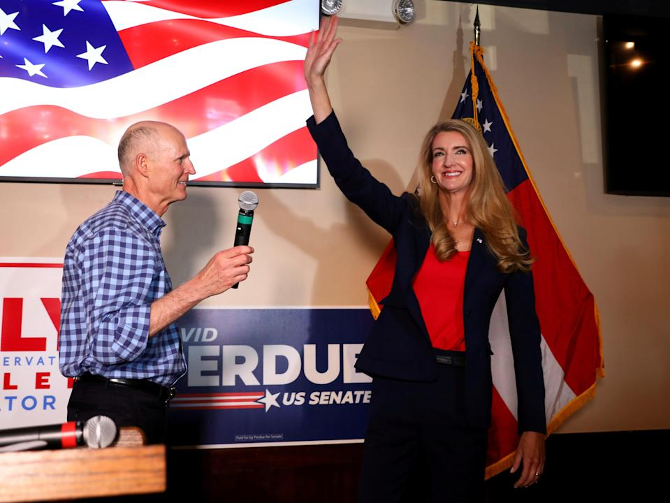 US senator Kelly Loeffler salutes as she takes the stage after senator Rick Scott (R-FL) delivered a speech during a campaign event for senators David Perdue and Loeffler in Cumming, Georgia, on 13 November 2020 ((Reuters))