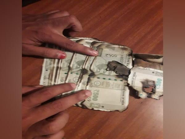 Money used during the trap laid by ACB were burned by forest official wife. (Photo/ANI)