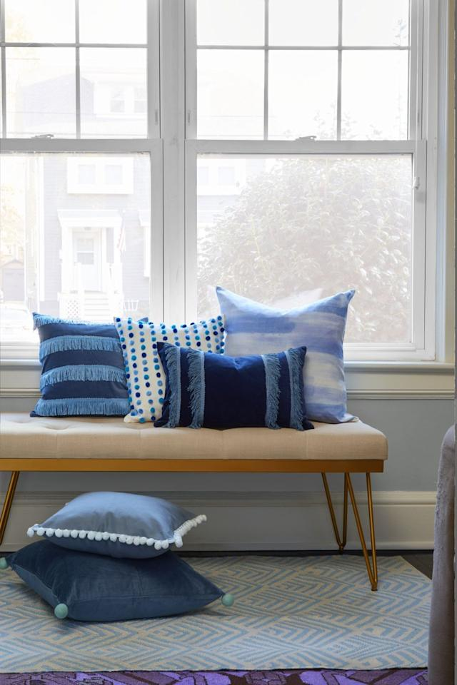 """<p>Pump up the pretty in your reading nook or couch. Create one-of-a-kind cushions by adding trims or giving a plain white pillow case a watercolor motif. </p><p><strong><a href=""""https://www.womansday.com/home/crafts-projects/a17764644/how-to-make-pillows/"""" target=""""_blank"""">Get the tutorial</a>.</strong></p>"""