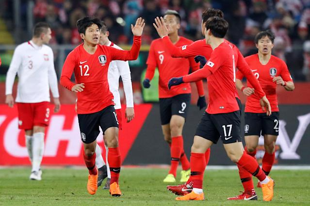 Soccer Football - International Friendly - Poland vs South Korea - Silesian Stadium, Chorzow, Poland - March 27, 2018 South Korea players celebrate after teammate Hwang Hee-chan scores their second goal REUTERS/Kacper Pempel