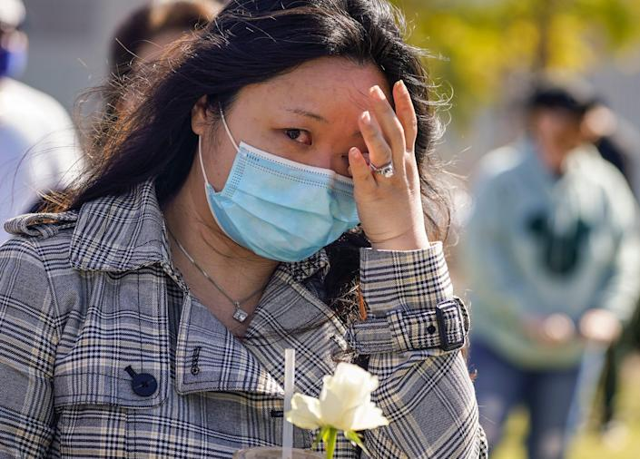 Esther Song tears up as she attends a community rally to raise awareness about anti-Asian violence and racist attitudes, in response to the string of violent racist attacks against Asians during the pandemic, held at Los Angeles Historic Park near the Chinatown district in Los Angeles, Saturday, Feb. 20, 2021.