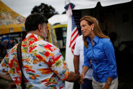 FILE PHOTO: US Democratic congressional candidate Mikie Sherrill (R) campaigns as people attend the New Jersey State Fair in Augusta, New Jersey, U.S., August 12, 2018. REUTERS/Eduardo Munoz/File Photo
