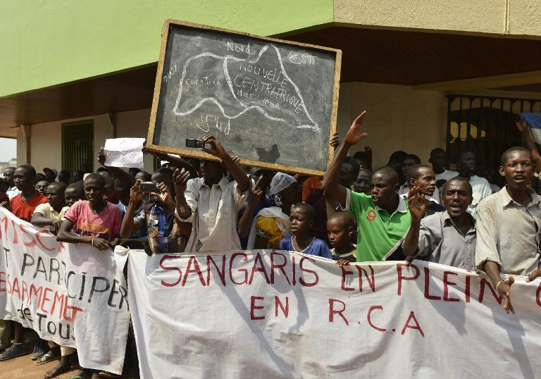 Central Africa's Muslims, accusing French soldiers of siding with the country's Christian population, demonstrate in the PK0 neighborhood in Bangui on December 24, 2013