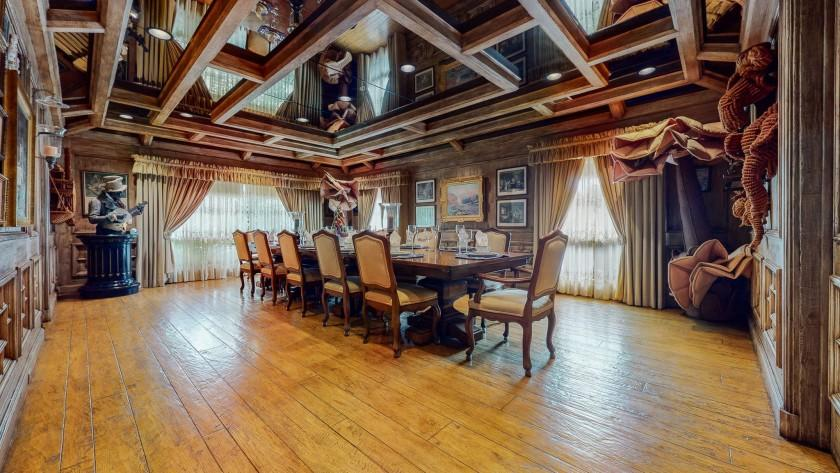 Hackett used to hold weekly luncheons for comedians in the home's massive dining room complete with paneled walls and mirrored ceilings.