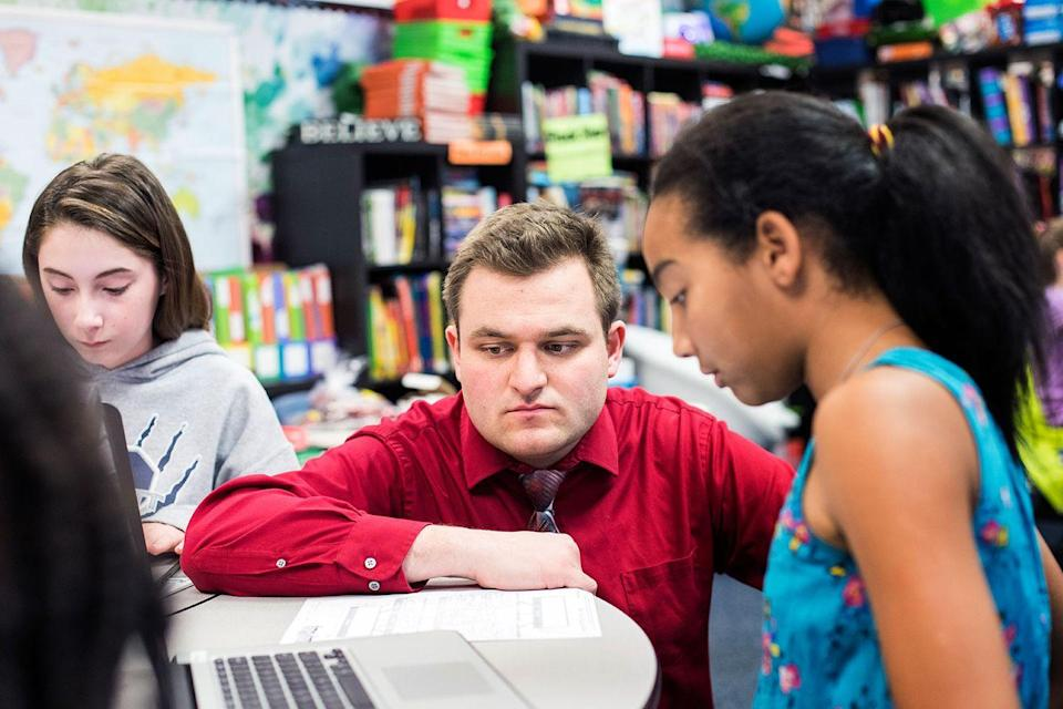 <p>Virginia's Teacher of the Year gives some guidance to his fifth grade student.</p>