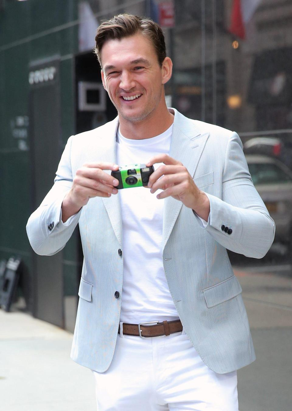 <p>Tyler Cameron snaps photos outside of <em>Good Morning America</em> while promoting his new book, <em>You Deserve Better</em>, in N.Y.C. on July 27.</p>