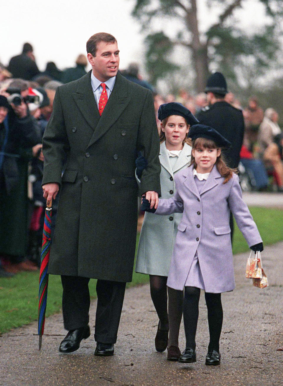 The cute girls held on to their father, Prince Andrew's hand in 1998 during a wet Christmas Day. Photo: Getty Images