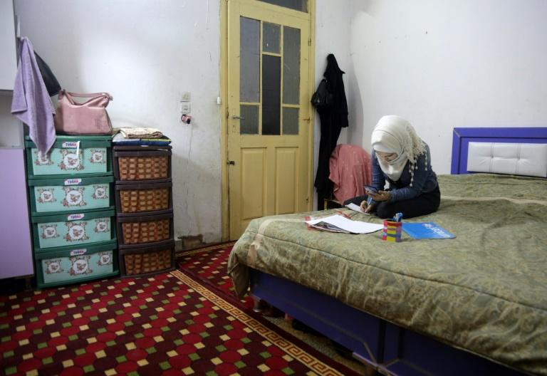 Distance learning is no small feat in a country battered by nine years of war, where fighting has displaced millions and the electricity supply is sporadic at best (AFP Photo/Aref TAMMAWI)