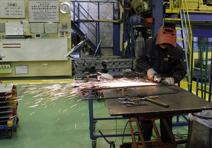 A worker cuts a metal at a sheet metal processing company Yamada Manufacturing in Daito, Osaka prefecture