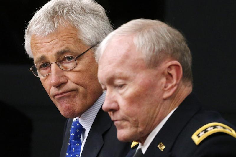 Defense Secretary Chuck Hagel and Chairman of the Joint Chiefs of Staff Gen. Martin Dempsey speak during a news conference at The Pentagon, Wednesday, Sept. 18, 2013. Hagel is ordering the Pentagon to review the physical security of all U.S. defense facilities worldwide and the security clearances that allow access to them. Hagel ordered the reviews in response to Monday's shooting rampage at the Washington Navy Yard, where gunman Aaron Alexis killed 12 people before being killed in a shootout with police. (AP Photo/Charles Dharapak)